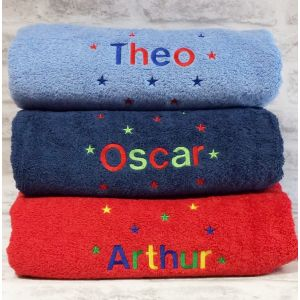 Helvetica font. Cobalt Towel Theo - Royal Blue + Red. Navy Towel Oscar - Red + Lime Green. Red Towel (Discontinued) Arthur - Royal Blue + Grass Green +Yellow